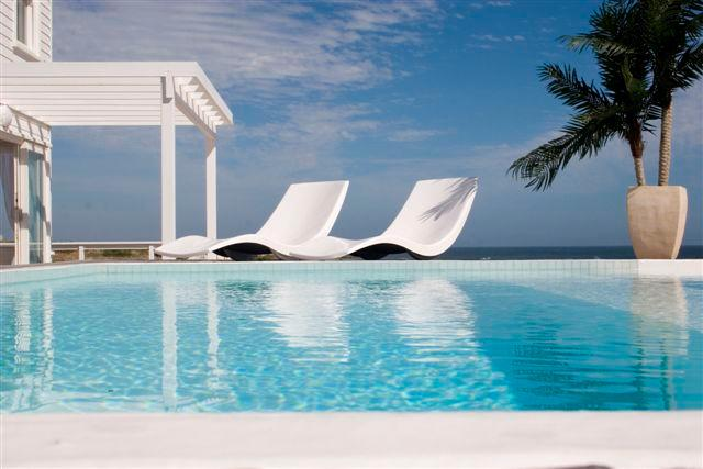 The gorgeous pool deck overlooking the sea