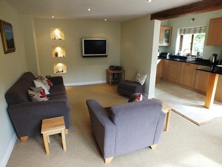 The sitting area with wall mounted TV