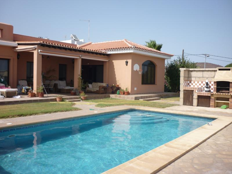 view of villa and pool and barbecue area.