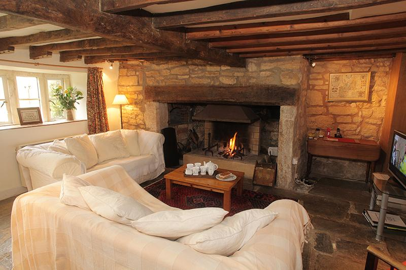 Sitting Room with inglenook fireplace and log fire