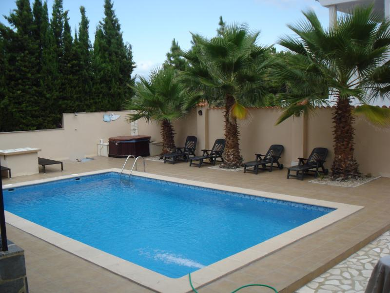 Plenty of sunbeds around the large pool area at this lovely modern villa