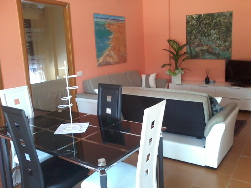 Air-conditioned dining room and living room with 2 sofa beds - all