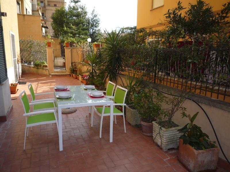 Nice terrace with dining set to enjoy your meal with the nice weather of Rome