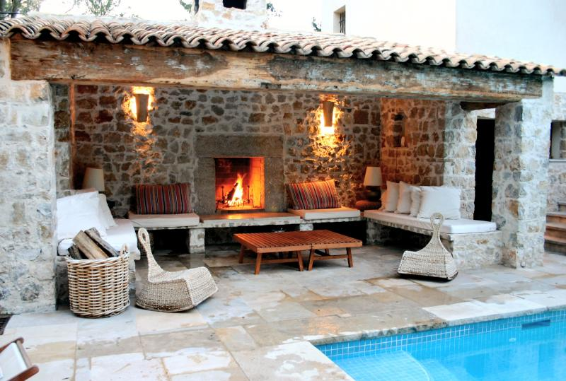 Outdoor lounging area with fireplace for cosy evenings