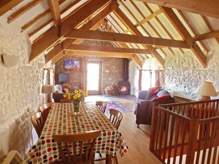Converted granary with upside down living and access to small balcony with views towards coast