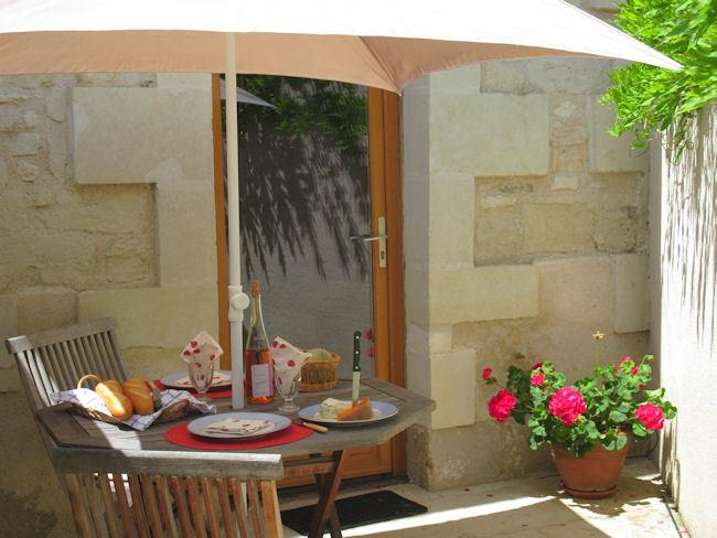 Step out of Layon cottage onto a lovely sheltered, sunny terrace and enjoy alfresco dining