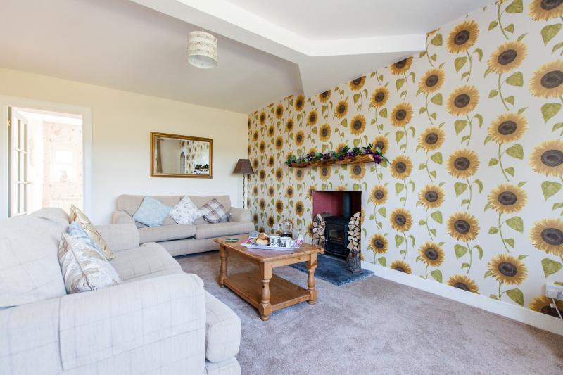 Spacious living room with views to front and log burner to toast your toes at on those chilly nights