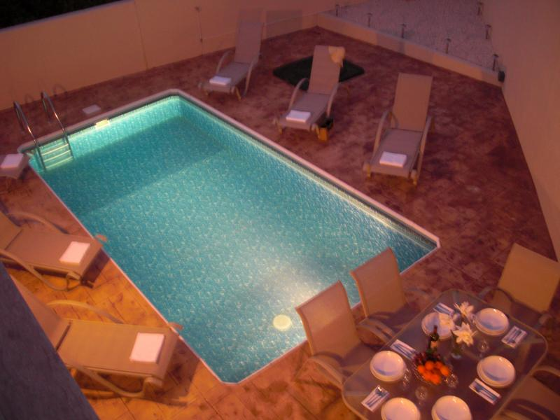 The illuminated pool is perfect for enjoying warm summer evenings.