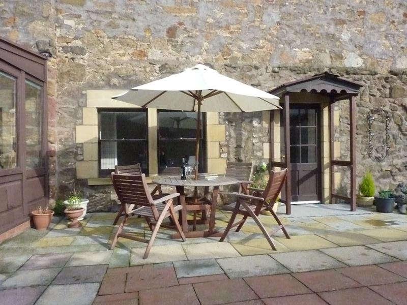 The private courtyard is a peaceful place to sit and enjoy a meal or a drink. Fully enclosed.