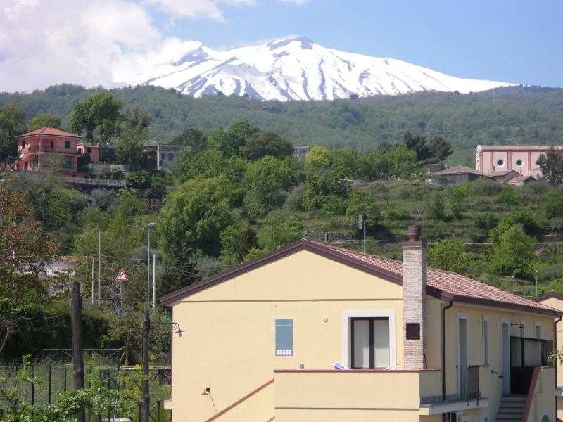 View from the side of the house wtih mount Etna behind