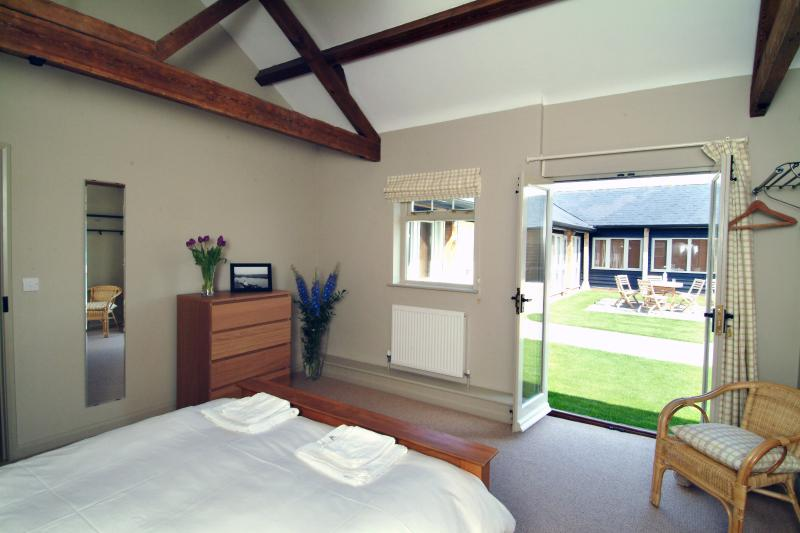 Double bedroom 2 with french windows to courtyard