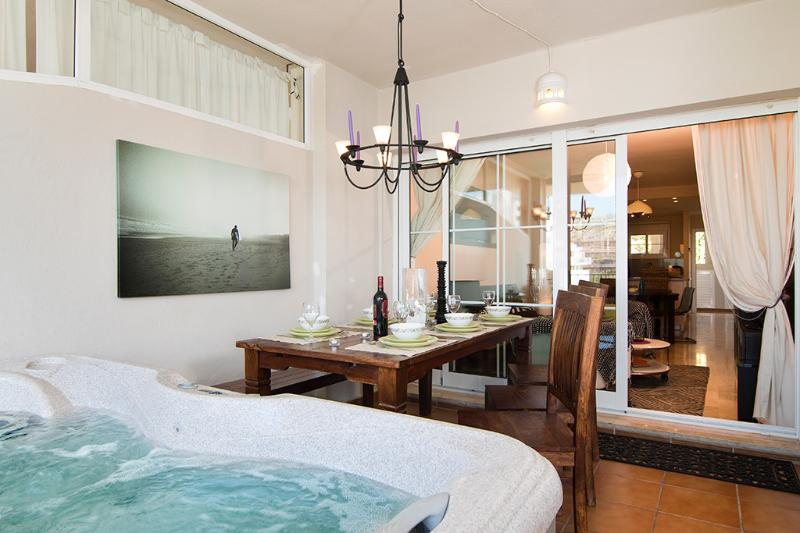 Relax in your Holiday Rental Apartment with a drink in