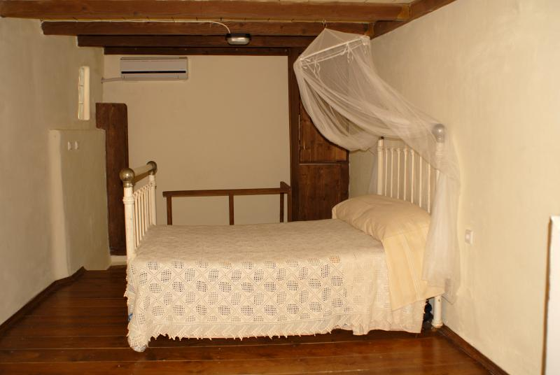 A sunny, spacious bedroom on the first floor (a double and a single bed) leads to the balcony