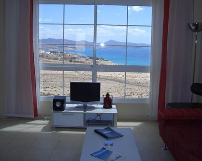 Amazing view from the lounge window of Costa Calma town, beautiful blue sea and distant mountains