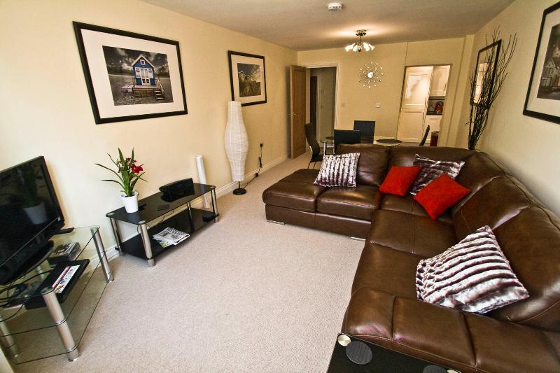 Living Room with comfy leather sofas, free WiFi and TiVo TV package