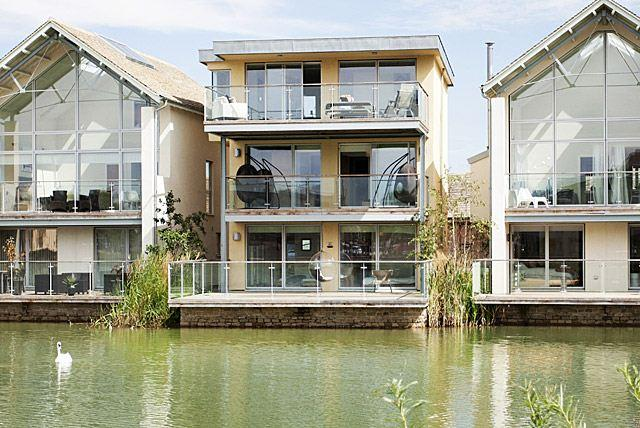 Howells Mere 27 ( middle  3 storey detached south west facing lakeside house)