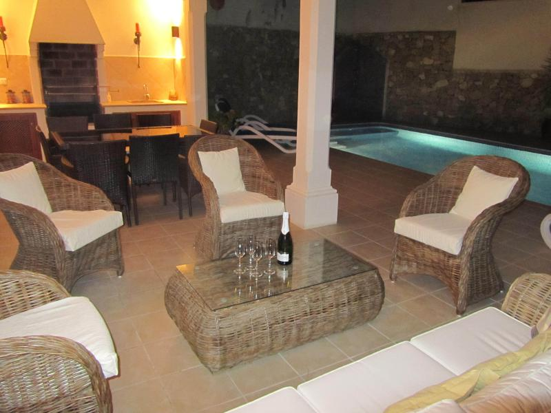 Relax in the Evening with a Glass of Wine by the Illuminated Pool