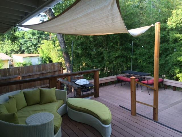 Beautitful back patio, surrounded in bamboo with string lighting