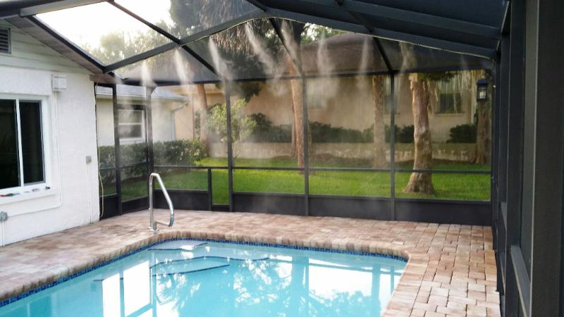 Heated, saltwater pool with misting system lowers temp around pool by 15 degrees