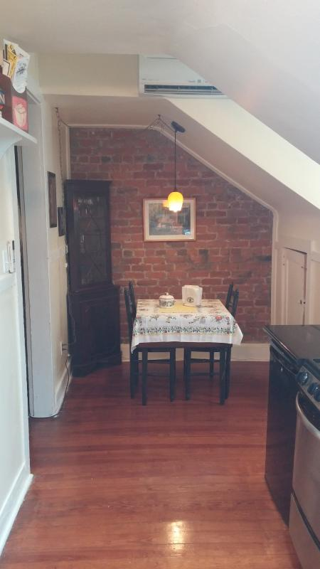 Entry way into your French Quarter home! Exposed brick and eat-in kitchen.