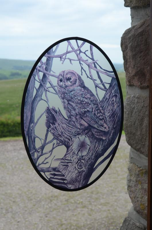 Our Owl cottage logo at the entrance
