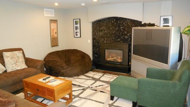 Living Room with Bean chair, gas fireplace, TV.