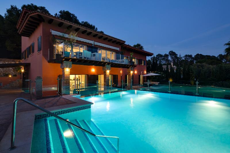 Night shot of heated pool and villa.