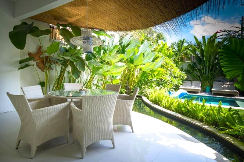 Open Dining surrounded by a fishpond, overlooking to pool