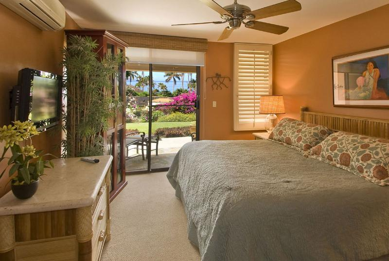Master Bedroom has King Select Comfort bed, a private ocean view lanai