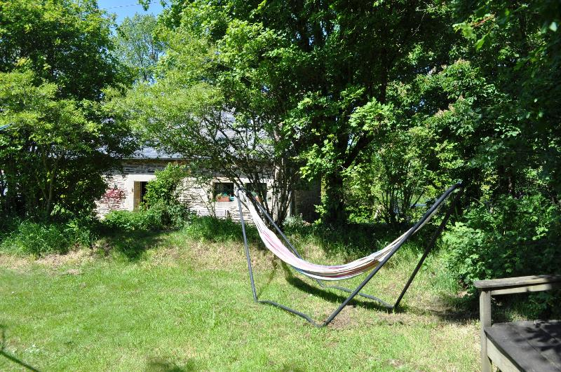 Extensive meadow in front of the gite, with sun trap complete with hammock and loungers