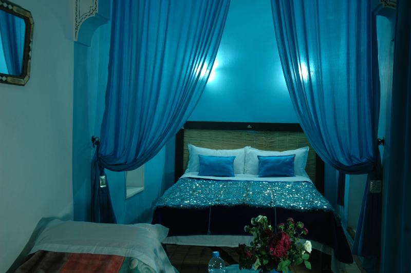 Turquoise blue private suite located on first floor and looking into the gorgeous courtyard garden..