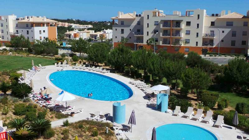 View of main swimming pools and garden from this superb penthouse apartment in Block 40