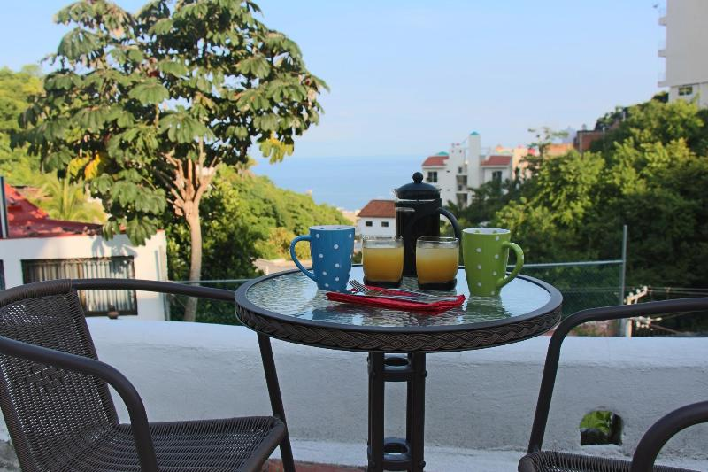 Enjoy morning coffee by the pool less than 10 minutes walk to the beach