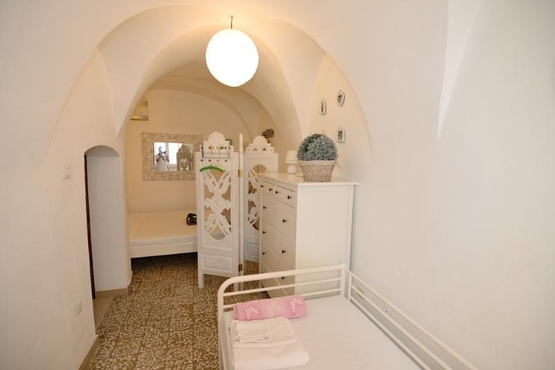 The 1st bedroom has a double and a day bed. The curved ceilings are very pretty and Sardinian.
