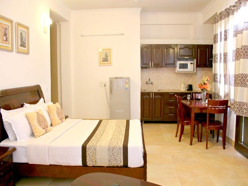 Bed at Olive Studio Service Apartments Gurgaon