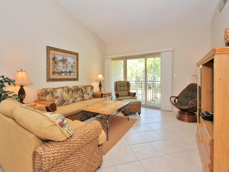 Living Room with Balcony Access at 1721 Bluff Villa
