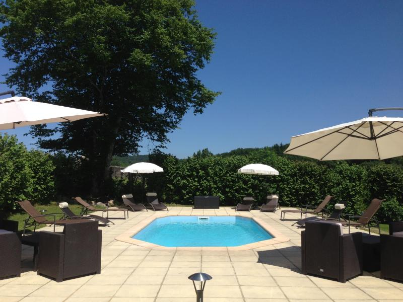 Heated Pool with relaxing sun-loungers & amazing views, ideal for cooling off on hot sunny days