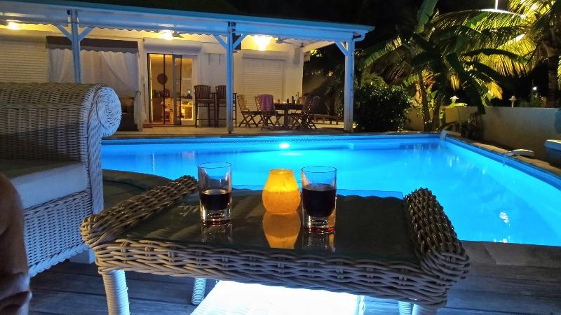 Oyster Bay View Villa evening drinks by the pool table Two chairs and sofa ( Use the large Parasol f