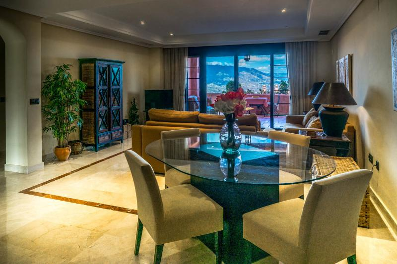 The living room has wide doors leading to the terrace and has an LCD TV, DVD, CD/Radio and iPod