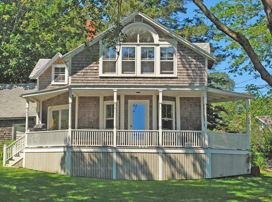 Blue Glass Cottage with its beautiful front covered porch and large yard