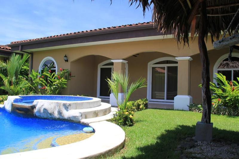 Beautifully landscaped backyard with private pool and hammock area!