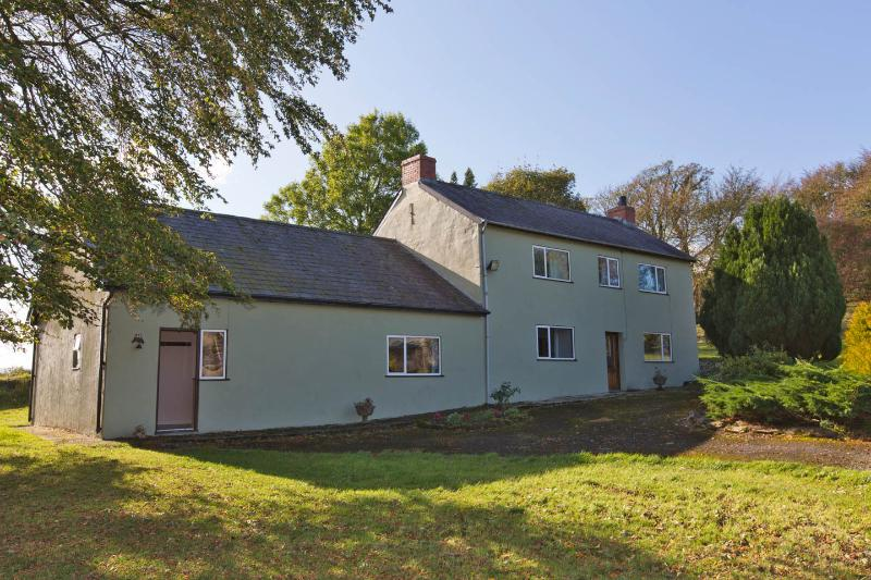 Old farmhouse with large lawns for children to run or relax with views over the surrounding farmland