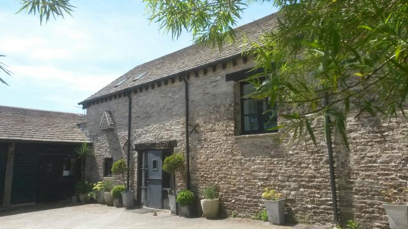 The 19th century converted purbeck stone barn, set in meadows overlooking the sea