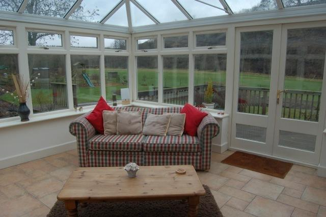 View the lovely surroundings from the conservatory.