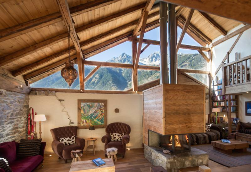 Chalet Bibendum spacious living with views of Flegere and Brevent area's (early afternoon)
