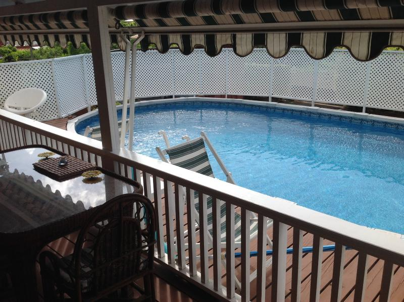 the pool has its own deck with a gate for children safety