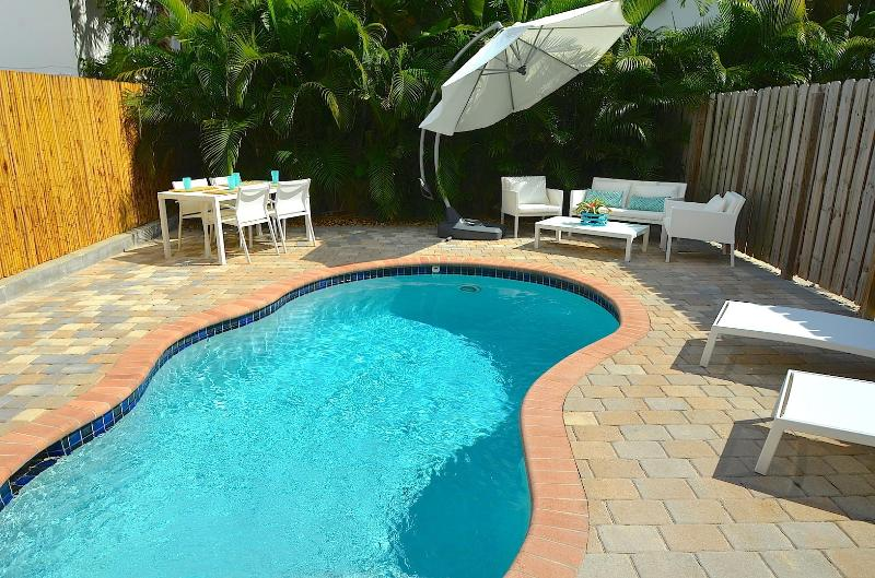 Spectacular Private Oasis Offering Heated Pool, Outdoor Dining & Relaxing Lounge Area...