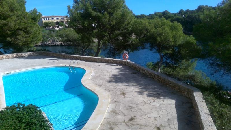 Pool area with views over the Cala Ferrera bay