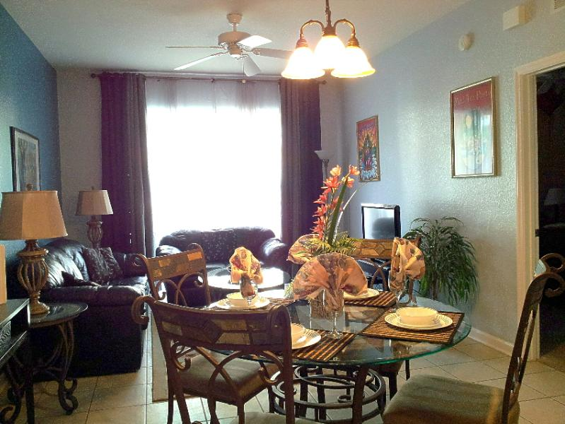 GREAT ROOM with living & dining areas. New painting on walls and new curtains. Lanai behind curtains.
