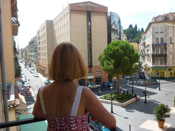 View from the balcony: Place du Pin and the park of Castle Hill in the background